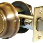 Mul-T-Lock Decorative Dedbolt in Antique Brass